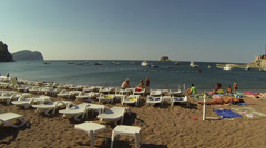 People Relaxing on the Beach Stock Footage