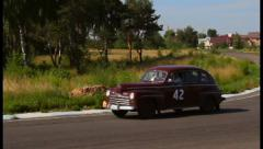 Stock Video Footage of Wide shot of sluggish Ford Super Deluxe moving slowly, click for HD