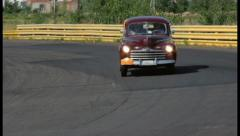 Ford Super Deluxe driving slowly at countryside, click for HD Stock Footage