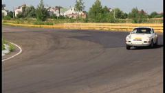 Sport car Porsche 911 approaching. Retro automobiles competition, click for HD - stock footage