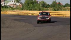 Rare vintage auto Datsun P510 driving over the village, click for HD Stock Footage