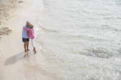 Stock Photo of Seniors couple kissing at beach