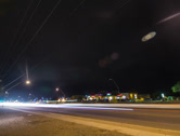 Stock Video Footage of 4K 24p Night traffic with lightning on horizon time lapse