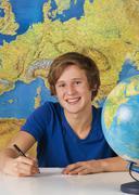 Teenage boy smiling, portrait - stock photo