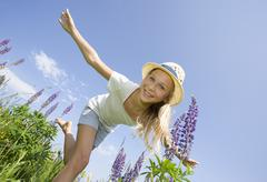 Austria, Teenage girl doing gymnastics in field, smiling, portrait Stock Photos