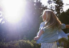 Austria, Teenage girl dancing in sunlight Stock Photos