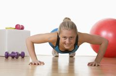 Stock Photo of Europe, Austria, Teenage girl exercising in gym, portrait