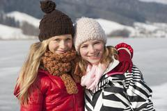 Austria, Teenage girls smiling, portrait Stock Photos