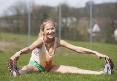 Austria, Teenage girl doing gymnastics, smiling, portrait Stock Photos