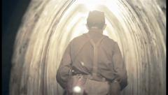 Soviet soldier walking through underground shelter. World war , click for HD - stock footage