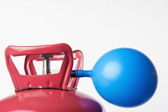 Helium tank to fill party balloons, close up Stock Photos