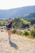 Stock Photo of USA, Texas, Young woman jogging