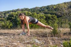 Stock Photo of USA, Texas Young woman stretching