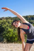 USA, Texas Young woman stretching - stock photo