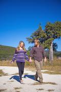 USA, Texas, Man and pregnant woman walking Stock Photos