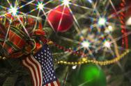 Stock Photo of Artifical christmas tree with lights and American flag