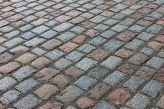 Old stone paved avenue street road Stock Photos