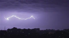 Thunder and lightning above city sky. Lightning forks to buildings, sound Stock Footage