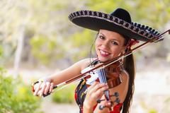 USA, Texas, Young woman playing violin, smiling, portrait Stock Photos