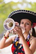 USA, Texas, Young woman playing trumpet Stock Photos