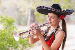 USA, Texas, Young woman playing trumpet Stock Photos