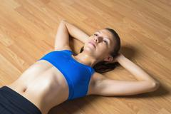 Young woman relaxing on wooden floor Stock Photos