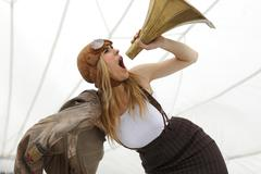 Germany, Paderborn, Woman shouting into Gramophone funnel Stock Photos