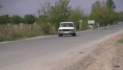 Old Lada drives on Armenian road Stock Footage
