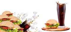 Delicious fast food with burger and cola Stock Photos