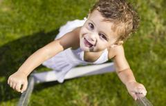 Stock Photo of Spain, Baby girl climbing, smiling