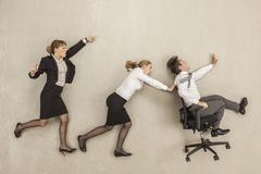 Business people chasing in office - stock photo