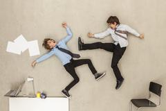Business boys fighting in office Stock Photos