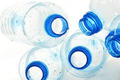 Composition with empty polycarbonate plastic bottles of mineral Stock Photos