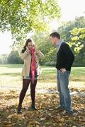 Germany, Berlin, Couple arguing in autumn park Stock Photos