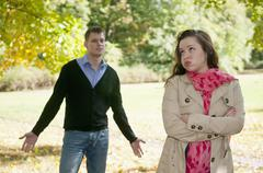 Germany, Berlin, Couple arguing in autumn park - stock photo