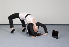 Germany, Berlin, Businesswoman bending over backwards with digital tablet - stock photo