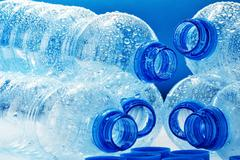 composition with empty polycarbonate plastic bottles of mineral - stock photo