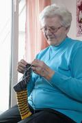 Germany, Berlin, Senior woman knitting socks, close up Stock Photos