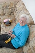 Stock Photo of Germany, Berlin, Senior woman knitting socks, close up