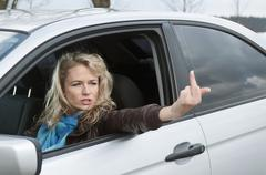 Germany, Brandenburg, Angry woman showing obscene gesture Stock Photos