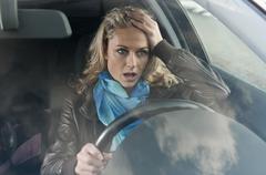 Germany, Brandenburg, Stress woman in car Stock Photos