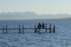 Europe, Germany, Bavaria, Man and woman relaxing at Lake Ammersee Stock Photos