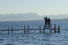 Stock Photo of Europe, Germany, Bavaria, Man and woman relaxing at Lake Ammersee