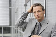 Europe, Germany, Bavaria, Close up of stress businessman Stock Photos