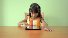 Young Asian Girl Using a Tablet PC - stock footage