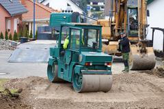 Stock Photo of Europe, Germany, Rhineland Palatinate, Steamroller for house foundation