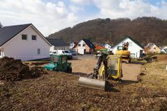 Stock Photo of Europe, Germany, Rhineland Palatinate, Preparing ground for foundation of house