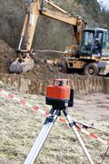Europe, Germany, Rhineland Palatinate, Measurement with laser in front of house - stock photo