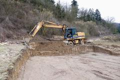 Stock Photo of Europe, Germany, Rhineland Palatinate, Preparing ground for foundation of house
