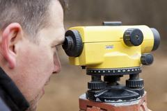 Europe, Germany, Rhineland Palatinate, Mature man looking through theodolite Stock Photos